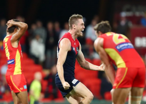 Tom McDonald kicks the point to win the game for the Melbourne Demons